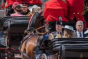 """Kate, Camilla and Harry (saluting) enter Buckingham Palace followed by Edward and Andrew - Trooping the Colour by the Irish Guards on the Queen's Birthday Parade. The Queen's Colour is """"Trooped"""" in front of Her Majesty The Queen and all the Royal Colonels.  His Royal Highness The Duke of Cambridge takes the Colonel's Review for the first time on Horse Guards Parade riding his horse Wellesley. The Irish Guards are led out by their famous wolfhound mascot Domhnall and more than one thousand Household Division soldiers perform their ceremonial duty. The Soldiers will parade in the traditional ceremonial uniforms of the Household Cavalry, Royal Horse Artillery, and Foot Guards. They are accompanied by the Household Division Bands & Corps of Drums. London 17th June 2017."""