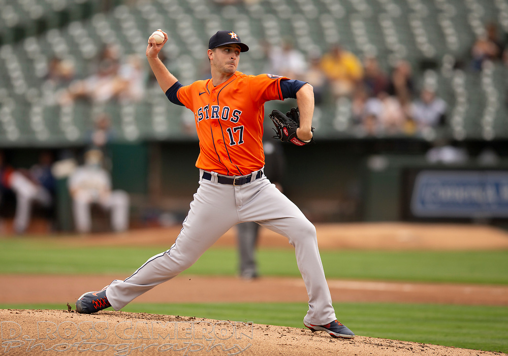 Sep 26, 2021; Oakland, California, USA; Houston Astros starting pitcher Jake Odorizzi (17) delivers a pitch against the Oakland Athletics in the first inning at RingCentral Coliseum. Mandatory Credit: D. Ross Cameron-USA TODAY Sports