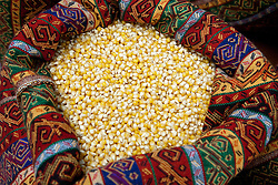 Middle East, Israel, Akko, colorful fabric sack of dried corn in market