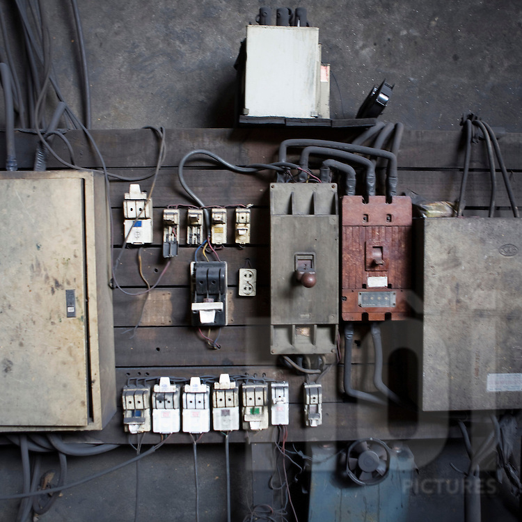 Color film photograph of an electric panel in a workshop of Da Hoi steel production craft village, Hanoi outskirts, Vietnam, Southeast Asia