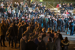 """© Licensed to London News Pictures . 03/11/2017 . Manchester , UK . Hundreds of fans of Tommy Robinson (real name Stephen Yaxley-Lennon ) queue up for books at the launch of the former EDL leader's book """" Mohammed's Koran """" at Castlefield Bowl . Originally planned as a ticket-only event at Bowlers Exhibition Centre , the launch was moved at short notice to a public location in the city . Photo credit : Joel Goodman/LNP"""