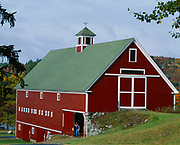 Stan Newton standing in door of the Hillside Inn barn, Newfound Lake, East Hebron, New Hampshire.