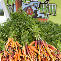 Breezy Hill's colorful purple, yellow and orange carrot bunches.