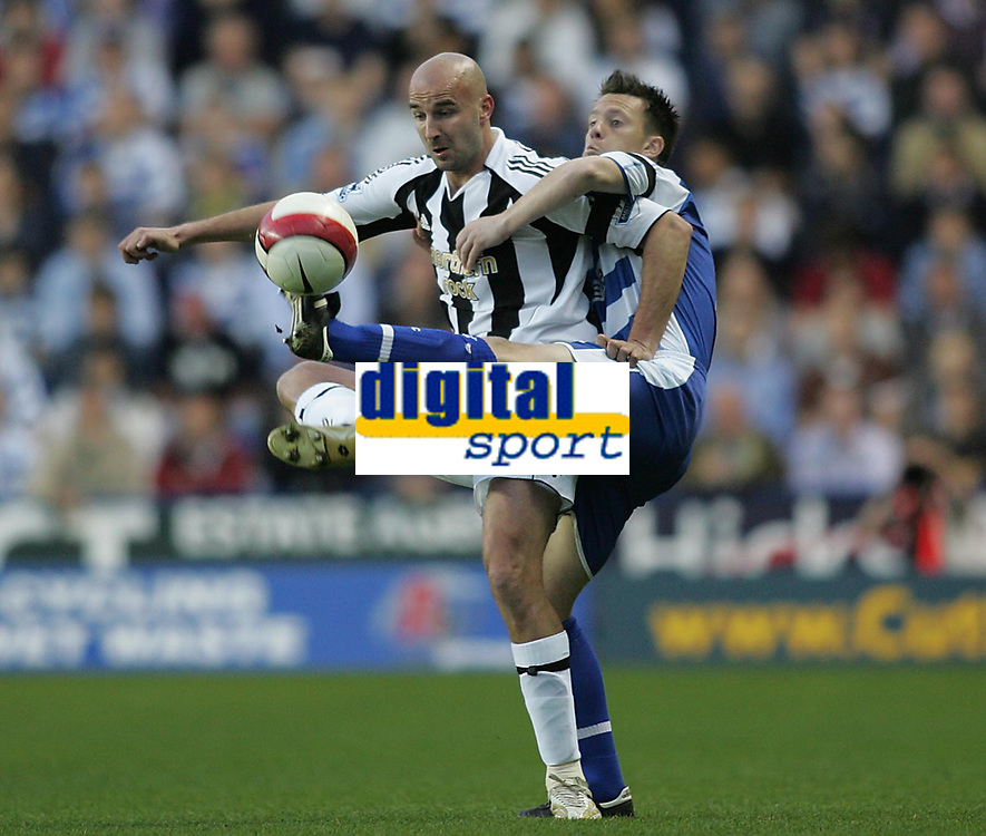 Photo: Lee Earle.<br /> Reading v Newcastle United. The Barclays Premiership. 30/04/2007.Newcastle's Antoine Sibierski (L) battles with Nicky Shorey.