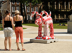 "© Licensed to London News Pictures. 29/06/2013. Bristol, UK. ""Bark at Ee"", designed by Leigh Flurry at Red Central, one of the Gromit Unleashed sculptures are placed around Bristol, this one in Queens Square.  From Monday 1st July, Bristol will be home to 80 iconic giant Gromit sculptures as our public arts trail Gromit Unleashed takes to the streets.  The 5 foot high sculptures which have been painted by artists will be placed in various locations around Bristol and will eventually be auctioned for charity.  All proceeds from Gromit Unleashed will benefit Wallace & Gromit's Grand Appeal, the Bristol Children's Hospital Charity.  Gromit is a character from the popular Aardman Animation series of films and was designed by Nick Park.  29 June 2013.<br /> Photo credit : Simon Chapman/LNP"