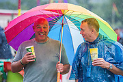 As usual, the rain begins to fall and fails to dampen spiriits. The 2014 Glastonbury Festival, Worthy Farm, Glastonbury. 26 June 2013.  Guy Bell, 07771 786236, guy@gbphotos.com