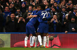 Chelsea's Gonzalo Higuain (left) celebrates scoring his side's first goal of the game with team mates