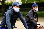 People are seen cycling on nearly empty Pall Mall Street facing the Kingdom's Buckingham Palace in London, Britain, on Sunday, May 3, 2020. Britons are now in their sixth week of lockdown due to the Coronavirus pandemic. Countries around the world are taking increased measures to stem the widespread of the SARS-CoV-2 coronavirus which causes the Covid-19 disease. (Photo/ Vudi Xhymshiti)