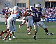 Kansas State quarterback Josh Freeman (1) fights his way past Oklahoma State defensive back Jocob Lacey (17) for a 21-yard touchdown run with a minute left in the game, to give the Wildcats the lead at Bill Snyder Family Stadium in Manhattan, Kansas, October 7, 2006.  The Wildcats beat the Cowboys 31-27.<br />