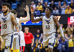 Dec 1, 2018; Morgantown, WV, USA; West Virginia Mountaineers forward Andrew Gordon (12) celebrates with teammates during the second half against the Youngstown State Penguins at WVU Coliseum. Mandatory Credit: Ben Queen-USA TODAY Sports