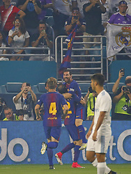 Barcelona forward Lionel Messi celebrates with teammates after scoring a goal during the first half against Real Madrid in International Champions Cup action on Saturday, July 29, 2017, at Hard Rock Stadium in Miami Gardens, FL, USA. Photo by David Santiago/El Nuevo Herald/TNS/ABACAPRESS.COM