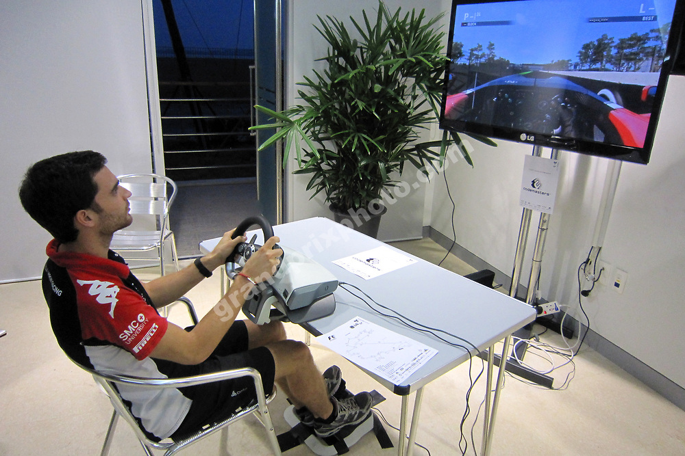 Jerome D Ambrosio (Virgin-Cosworth) trying the new Codemasters PS3 F1 game before the 2011 Korean Grand Prix at the International circuit in Yeongam. Photo: Grand Prix Photo