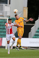 Scot Bennett of Newport county ® jumps for a teader with Billy Waters of Cheltenham Town (l).  EFL Skybet football league two match, Newport county v Cheltenham Town at Rodney Parade in Newport, South Wales on Saturday 10th September 2016.<br /> pic by Andrew Orchard, Andrew Orchard sports photography.