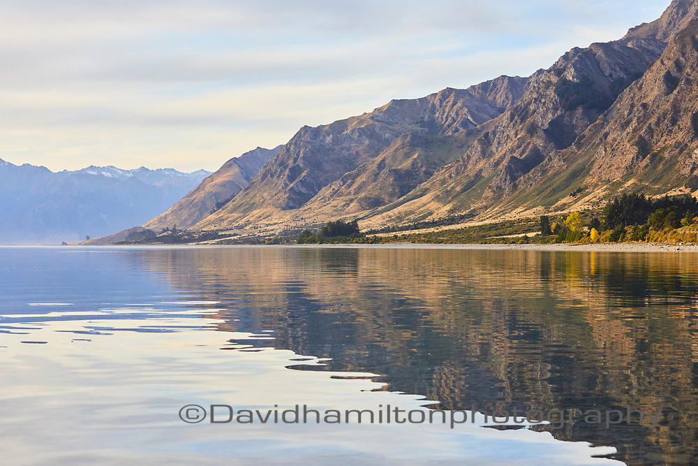 Lake Hawea in the South Island of New Zealand, on a still afternoon in autumn