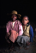 Portrait of local mother and daughter at home, Fianarantsua highlands.