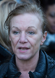 © London News Pictures. 11/01/2014. London, UK. Carole Duggan, the Aunt of Mark Duggan attending a vigil outside Tottenham Police Station in London, following a Coroners ruling of a lawful killing in the case of Mark Duggan earlier this week. Mark Duggan was hot dead by police in an incident that sparked riots across London and England.  Photo credit: Ben Cawthra/LNP