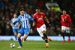 Manchester United's Anthony Martial tackles Brighton & Hove Albion's Pascal Gross