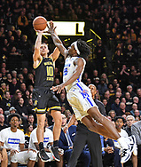 Erik Stevenson #10 of the Wichita State Shockers hits a three-point shot against Precious Achiuwa #55 of the Memphis Tigers during the first half on January 9, 2020 at Charles Koch Arena in Wichita, Kansas.