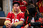 SAN FRANCISCO, CA - FEBRUARY 02: Jessica Rodriguez of Concord, California comforts her husband Tony Rodriguez during a Super Bowl LIV watch party after the Kansas City Chiefs defeat the San Francisco 49ers, at SPIN San Francisco on February 2, 2020 in San Francisco, California. The San Francisco 49ers faced the Kansas City Chiefs in Super Bowl LIV for their seventh appearance at the NFL championship, leading the game into half time and losing after 21 unanswered points in the second half of the game. (Photo by Philip Pacheco/Getty Images)
