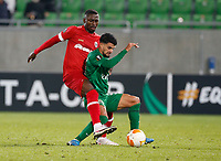 RAZGRAD, BULGARIA - OCTOBER 22: Cauly Souza of Ludogorets defends the ball from Martin Hongla of Antwerp during the UEFA Europa League Group J stage match between PFC Ludogorets Razgrad and Royal Antwerp at Ludogorets Arena on October 22, 2020 in Razgrad, Bulgaria. (Photo by Nikola Krstic/MB Media)