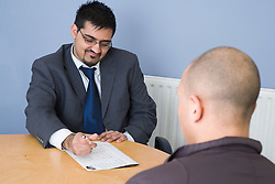 Two young men in an interview situation, Cleared for context of Refugee and Asylum Seekers