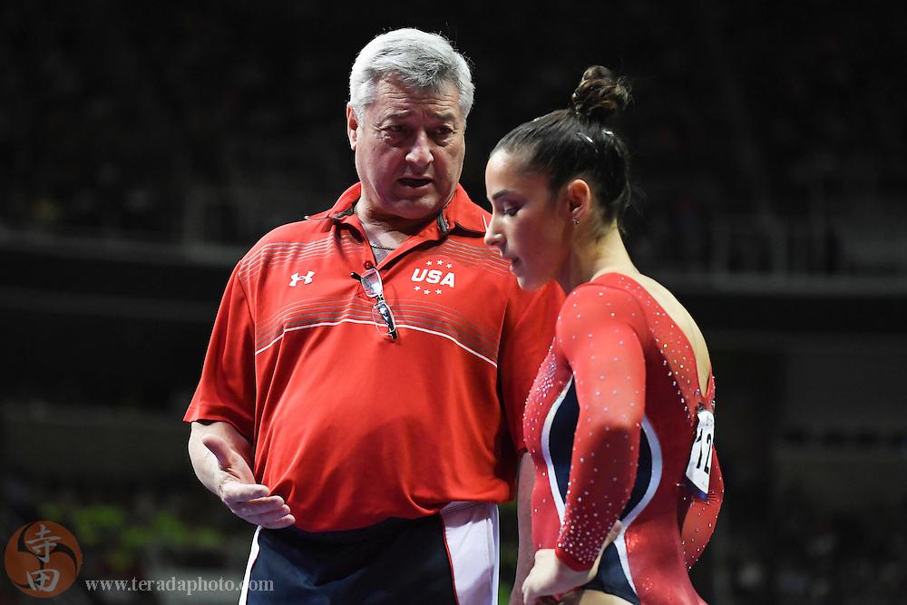 July 8, 2016; San Jose, CA, USA; Gymnastics coach Mihai Brestyan (left) instructs Aly Raisman (right), Needham, MA, during the women's gymnastics U.S. Olympic team trials at SAP Center.