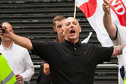 """Cricklewood, London, July 19th 2014. One of thirteen anti-Islamists from the far-right """"South East Alliance"""" trades insults with the scores of anti-fascist counter-protesters outside the London offices of Egypt's Muslim Brotherhood."""