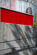 The red sides of a passing lorry and the head of a model as part of a giant ad for SEAT on the side of the IMAX cinema at Waterloo, SE1, on 19th August 2019, in London, England.