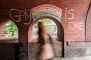 "In Utrecht is in een portiek de tekst 'Gay is oke' geschreven met krijt met de regenboog boven een van de portiekbogen.<br /> <br /> In Utrecht on a porch the text ""Gay is OK"" is written with chalk with the rainbow above one of the archways."