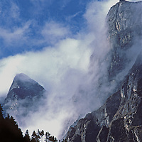 Clouds engulf cliffs above the Dudh Kosi River in the Khumbu region of Nepal.