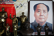 Mao souvenirs in one of Tang Ruiren's Mao Family  Restaurants near the birthplace of Mao Zedong, in Shaoshan, Hunan Province, China on 12 August 2009.  The village of Shaoshan, in rural Hunan Province, is tiny in size but big in name. It was the childhood home for Mao Zedong, the controversial revolutionary who came from obscurity but eventually defied all odds conquered China in the name of communism. Now his home, a sacred place among China's official propaganda, is in reality a microcosm of the country itself: part commercialism, part superstition, with a dash of communist ideological flavor.