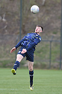 Leeds United defender Joe Stanley wins header during the U18 Professional Development League match between Coventry City and Leeds United at Alan Higgins Centre, Coventry, United Kingdom on 13 April 2019.