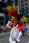 A supporter of U.S. Senator Kirsten Gillebrand wears a huge feathered headdress. Gillebrand is the junior senator from New York, and supports several progressive causes, including gay rights.
