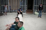 Trattenuti durante l'ora d'aria al CIE di Gradisca.<br /> Gradisca d'Isonzo (GO) ,10 settembre 2013. Daniele Stefanini / OneShot