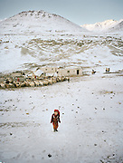 Chechen Gul (6 years old) returns from helping her mum with the sheep herd..Campment of Tshar Tash (Haji Osman's camp), in the Wakhjir valley, at the source of the Oxus..Winter expedition through the Wakhan Corridor and into the Afghan Pamir mountains, to document the life of the Afghan Kyrgyz tribe. January/February 2008. Afghanistan