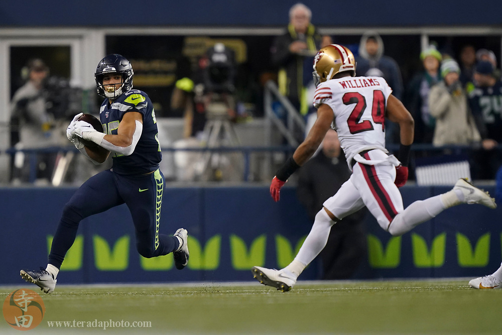 December 29, 2019; Seattle, Washington, USA; Seattle Seahawks running back Travis Homer (25) runs against San Francisco 49ers defensive back K'Waun Williams (24) during the second quarter at CenturyLink Field.