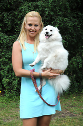 LIZ FULLER and her dog Amber at the Macmillan Dog Day in aid of Macmillan Cancer Support held at the Royal Hospital Chelsea, London on 8th July 2008.<br />