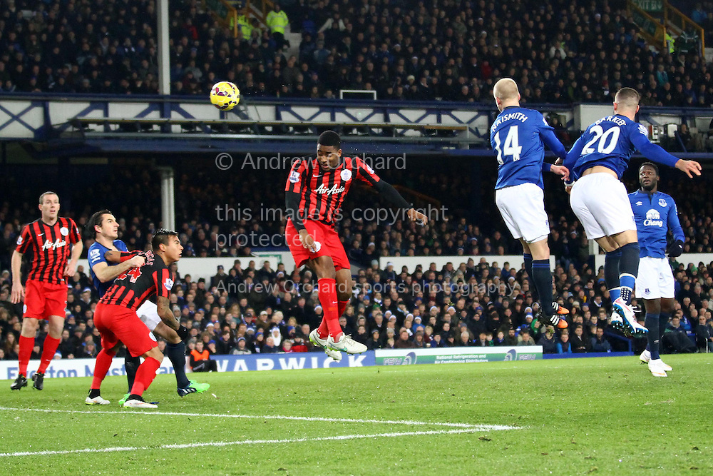 Leroy Fer of Queens Park Rangers heads towards goal but puts it wide. Barclays Premier league match, Everton v Queens Park Rangers at Goodison Park in Liverpool, Merseyside on Monday 15th December 2014.<br /> pic by Chris Stading, Andrew Orchard sports photography.