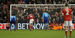 Nottingham Forest's Kieran Dowell (left) scores his side's fourth goal of the game from the penalty spot