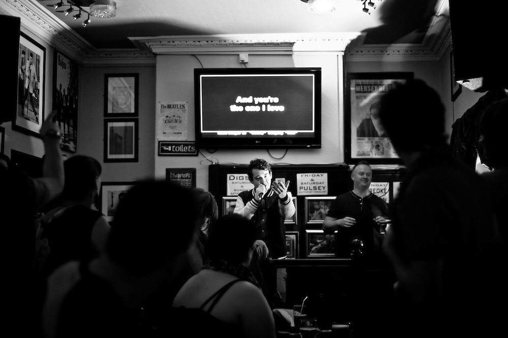 Liverpool, UK - 16 August 2012: Thursday karaoke night in a pub in the city centre.