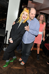 PAM HOGG and GAVIN TURK at W London - Leicester Square for the Liberatum Cultural Honour in Spice Market for John Hurt, CBE in association with artist Svetlana K-Lié on 10th April 2013.
