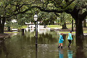 Young women walk through floodwater in historic White Point Gardens in the historic district as Hurricane Joaquin brings heavy rain, flooding and strong winds as it passes offshore October 4, 2015 in Charleston, South Carolina.