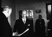 The new Taoiseach, Jack Lynch, recieves his seal of office from President Eamon de Valera at Áras an Uachtarain..10.11.1966