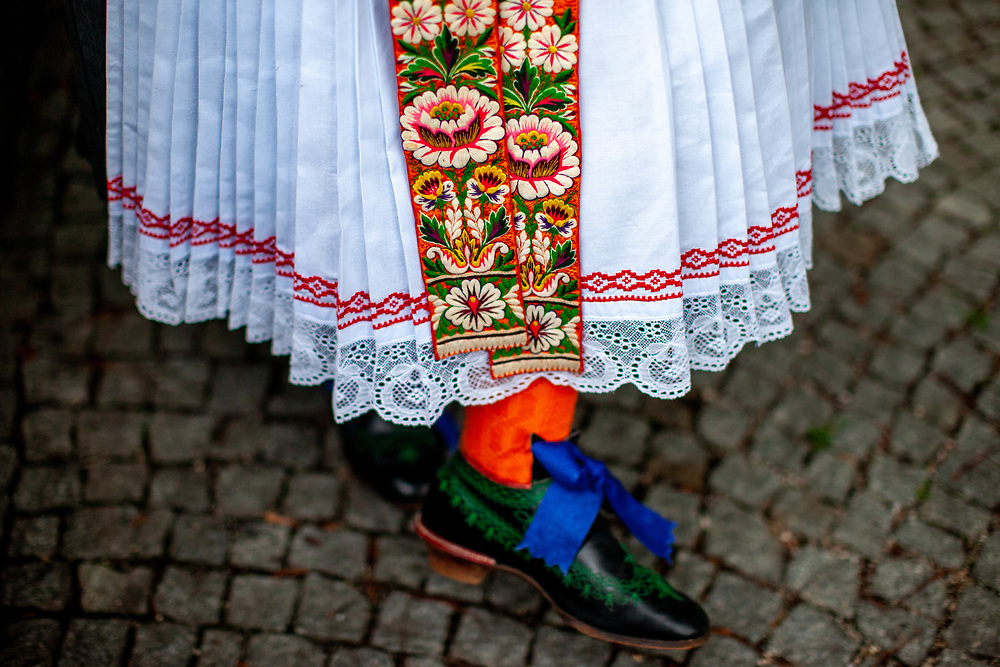 """Monika Ofner-Reim in a traditional Sudeten Germans dress and wearing the shoes her grandmother was wearing during her wedding. She belongs to the community """"Wischauer Sprachinsel""""  (Gemeinschaft Wischauer Sprachinsel) which keeps the traditions from the past alive. Photographed during the 71st Sudeten German meeting at the """"Philharmonie im Gasteig"""" in Munich."""