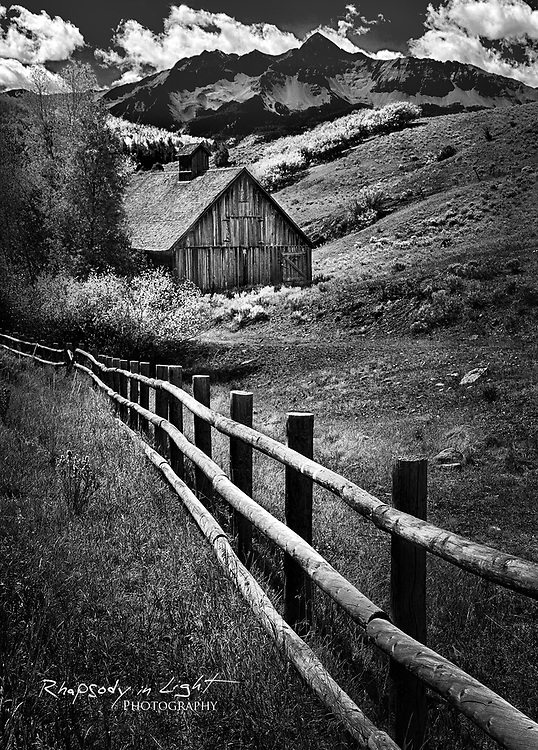 A rustic barn near Telluride. Photographers often avoid shooting during harsh midday light, but compelling black & white images can still be made at this time of day. In this noontime photo, the fence provided an effective leading line.