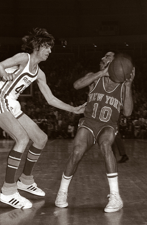 """Peter Press """"Pistol Pete"""" Maravich (June 22, 1947  January 5, 1988) guards New York's Walt Frazier. Maravich was an American professional basketball player of Serbian descent. He was born in Aliquippa, Pennsylvania, part of the Pittsburgh metropolitan area and raised in the Carolinas. Maravich starred in college at Louisiana State University (LSU) and played for three NBA teams until injuries forced his retirement in 1980. He is still the all-time leading NCAA Division I scorer with 3,667 points scored and an average of 44.2 points per game. All of his accomplishments were achieved before the three-point line and shot clock were introduced to NCAA basketball and despite being unable to play varsity as a freshman under then-NCAA rules. One of the youngest players ever inducted into the Naismith Memorial Basketball Hall of Fame, Maravich was cited by the Hall as """"perhaps the greatest creative offensive talent in history"""". In an April 2010 interview, Hall of Fame player John Havlicek said """"the best ball-handler of all time was Pete Maravich."""""""