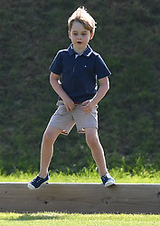 The Duchess of Cambridge, Prince George and Princess Charlotte watch The Duke of Cambridge play in The Maserati Royal Charity Polo Trophy at Beaufort Polo Club, Tetbury, Gloucestershire, UK, on the 10th June 2018. 10 Jun 2018 Pictured: Prince George. Photo credit: James Whatling / MEGA TheMegaAgency.com +1 888 505 6342