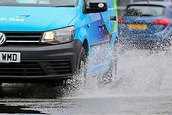 © Licensed to London News Pictures. 19/07/2019. London, UK. A car splashes water as it drives through a flood north London caused by heavy downpour. Photo credit: Dinendra Haria/LNP