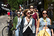 Girls hanging out together in Covent Garden, London, UK. All wearing sunglasses this group of young women walk in the sun as a pack.