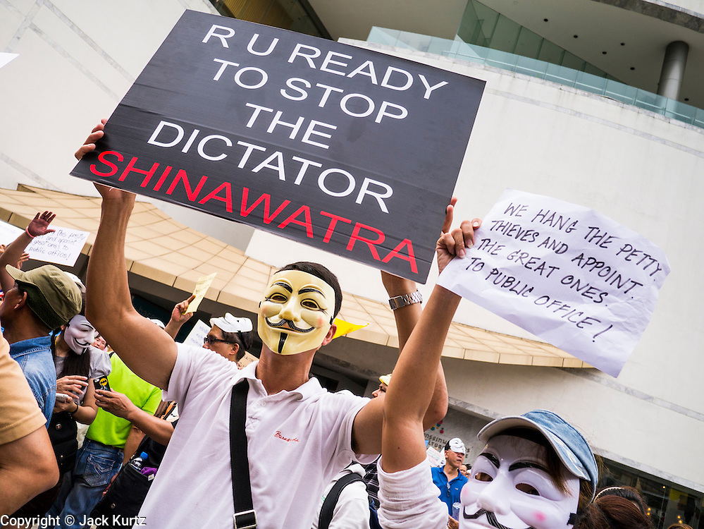 """02 JUNE 2013 - BANGKOK, THAILAND: An anti Yingluck Shinawatra protester in Bangkok. The so called White Mask protesters are strong supporters of the Thai monarchy. About 300 people wearing the Guy Fawkes mask popularized by the movie """"V for Vendetta"""" and Anonymous, the hackers' group, marched through central Bangkok Sunday demanding the resignation of Prime Minister Yingluck Shinawatra. They claim that Yingluck is acting as a puppet for her brother, former Prime Minister Thaksin Shinawatra, who was deposed by a military coup in 2006 and now lives in exile in Dubai.     PHOTO BY JACK KURTZ"""